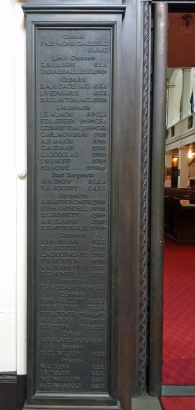 Men listed by rank on left side of door